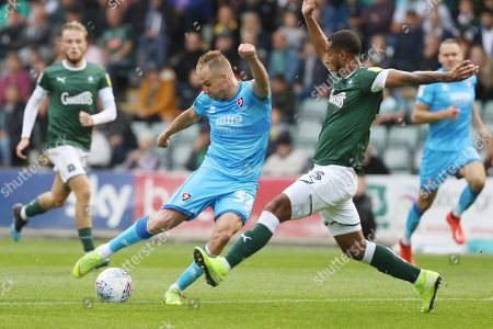 Josh Grant fails to block a Luke Varney shot that creeps just wide of the goal  during the EFL Sky Bet League 2 match between Plymouth Argyle and Cheltenham Town at Home Park, Plymouth