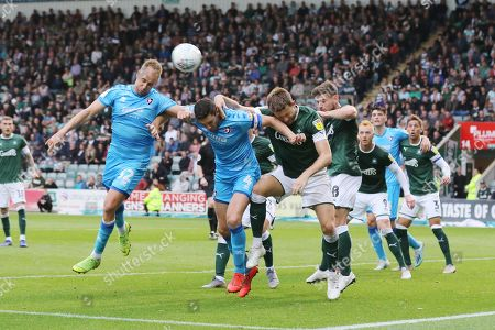 Luke Varney and Chris Hussey near post header from a corner is just off target during the EFL Sky Bet League 2 match between Plymouth Argyle and Cheltenham Town at Home Park, Plymouth