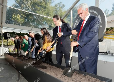 Stock Photo of Kevin Gover, Bill Lomax, Deb Haaland, Harvey Pratt, Jefferson Keel, Brenda Shopodock, Robert Wilkie, John Davis. With ceremonial shovel in hand, Kevin Gover, director of the National Museum of the American Indian, right, breaks ground for the National Native American Veterans Memorial, in Washington. From right to left, Bill Lomax, National Museum of the American Indian board of trustees chair; U.S. Rep. Deb Haaland; Harvey Pratt, memorial designer; Jefferson Keel, Lieutenant Governor of the Chickasaw Nation, National Congress of American Indians president, and National Native American Veterans Memorial Advisory Committee co-chair; Brenda Shopodock, Vice Chairwoman Forest County Potawatomi Community; Robert Wilkie, Secretary of Veterans Affairs; and John Davis, Smithsonian Institution Provost