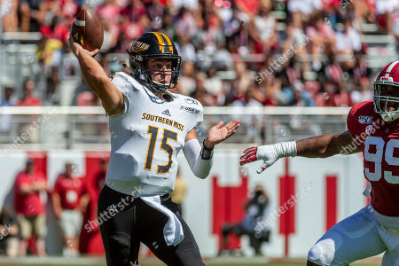 Southern Miss quarterback Jack Abraham (15) throws with pressure coming from Alabama defensive lineman Raekwon Davis (99) during the first half of an NCAA college football game, in Tuscaloosa, Ala