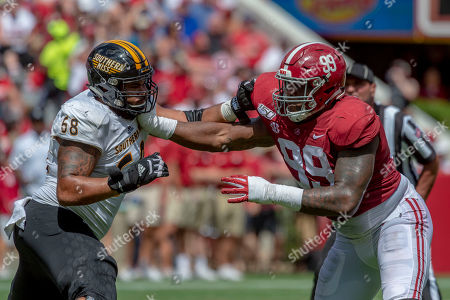 Southern Miss offensive lineman Bryce Foxworth (68) battles Alabama defensive lineman Raekwon Davis (99) during the first half of an NCAA college football game, in Tuscaloosa, Ala