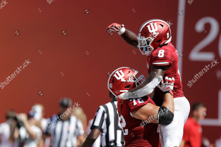 Indiana running back Stevie Scott III (8) celebrates with offensive lineman Simon Stepaniak (72) after Scott ran for a touchdown during the second half of an NCAA college football game against Connecticut, in Bloomington, Ind. Indiana won 38-3