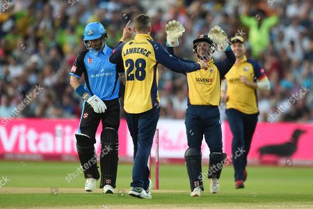 Daniel Lawrence and Adam Wheater of Essex Eagles celebrate the wicket of Hamish Rutherford during the Vitality T20 Finals Day 2019 match between Worcestershire County Cricket Club and Essex County Cricket Club at Edgbaston, Birmingham
