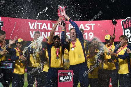 Simon Harmer and Ravi Bopara lift the Vitality Blast Trophy after beating Worcestershire during the Vitality T20 Finals Day 2019 match between Worcestershire County Cricket Club and Essex County Cricket Club at Edgbaston, Birmingham