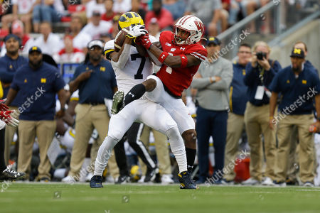 Wisconsin linebacker Spencer Lytle, right, breaks up a pass intended for Michigan wide receiver Tarik Black during the second half of an NCAA college football game, in Madison, Wis. Wisconsin won 35-24