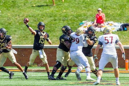 Wake Forest Demon Deacons quarterback Michael Kern (15) throws from the pocket in the NCAA matchup at BB&T Field in Winston-Salem, NC