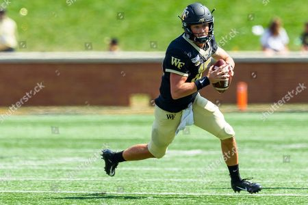 Wake Forest Demon Deacons quarterback Michael Kern (15) runs with the ball against Elon Phoenix in the NCAA matchup at BB&T Field in Winston-Salem, NC