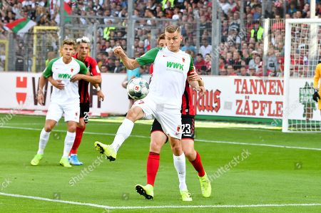 Stock Image of , and Alfred Finnbogason #27 (FC Augsburg) and Dominique Heintz #23 (SC Freiburg), SC Freiburg vs. FC Augsburg, Football, 1.Bundesliga, 23.02.2019,