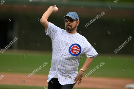 Actor James Michael Tyler throws out the ceremonial first pitch before a baseball game between the Chicago Cubs and St. Louis Cardinals, in Chicago