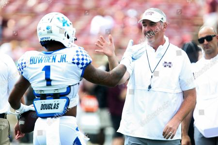 Mississippi State head coach Joe Moorhead greets Kentucky wide receiver Lynn Bowden Jr. (1) during warmups prior to an NCAA college football game, in Starkville, Miss