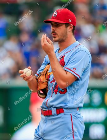 Stock Image of St. Louis Cardinals starting pitcher Dakota Hudson blows on his fingers after walking Chicago Cubs second baseman Ben Zobrist with the bases loaded, sending Chicago Cubs right fielder Nicholas Castellanos in to score in the sixth inning of the MLB game between the St. Louis Cardinals and the Chicago Cubs at Wrigley Field in Chicago, Illinois, USA, 21 September 2019.