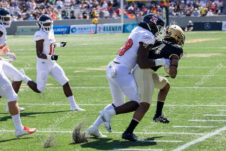 Morgan State defensive back Jordan Johnson (23) tackles Army quarterback Cade Ballard (4) during the first half of an NCAA college football game, in West Point, N.Y