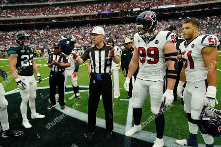 J.J. Watt, Dylan Cole, Calais Campbell, Cody Davis. Houston Texans defensive end J.J. Watt (99) and linebacker Dylan Cole (51) take part in the coin flip with Jacksonville Jaguars defensive end Calais Campbell (93) and defensive back Cody Davis (22) before an NFL football game against the Jacksonville Jaguars, in Houston