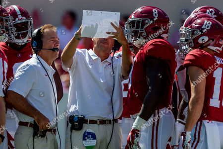 Southern Miss Alabama Football. Alabama head coach Nick Saban looks over a diagram as special teams coordinator/tight ends coach Jeff Banks explains it to linebacker Christian Harris (8) and others during the first half of an NCAA college football game against Southern Miss, in Tuscaloosa, Ala