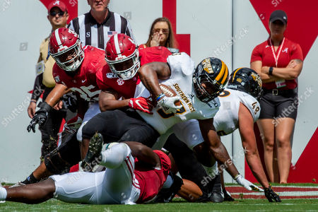 Southern Miss Alabama Football. Southern Miss running back Kevin Perkins (33) works to get one more yard against Alabama linebacker Christopher Allen (4) during the first half of an NCAA college football game, in Tuscaloosa, Ala