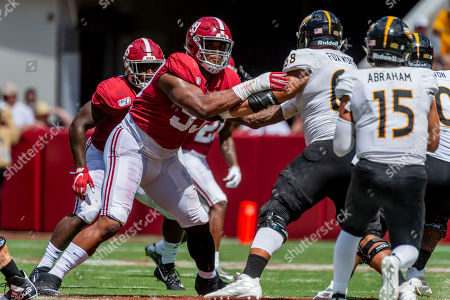 Southern Miss Alabama Football. Alabama defensive lineman Raekwon Davis (99) battles Southern Miss offensive lineman Bryce Foxworth (68) during the second half of an NCAA college football game, in Tuscaloosa, Ala