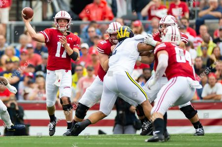 Wisconsin Badgers quarterback Jack Coan #17 throws a pass over the middle to Wisconsin Badgers tight end Jake Ferguson #84 during the NCAA Football game between the Michigan Wolverines and the Wisconsin Badgers at Camp Randall Stadium in Madison, WI. Wisconsin defeated Michigan 35-14