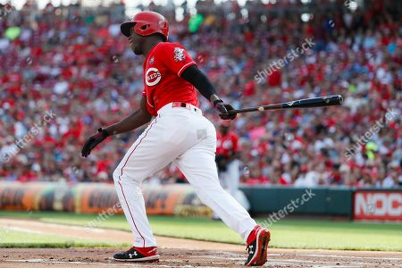 Stock Photo of Cincinnati Reds' Aristides Aquino hits an RBI-infield single off New York Mets starting pitcher Zack Wheeler in the first inning of a baseball game, in Cincinnati