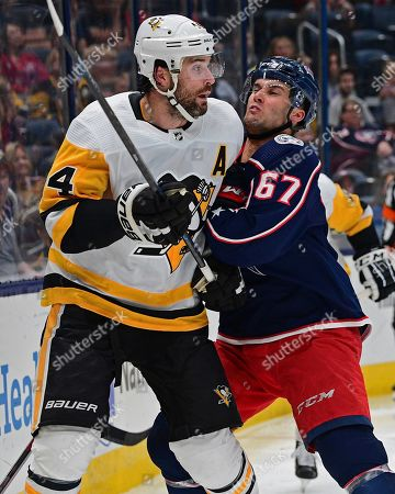 Columbus Blue Jackets' Justin Scott, right, checks Pittsburgh Penguins' Erik Gudbranson during the second period of a preseason NHL hockey game, in Columbus, Ohio. The Blue Jackets won 3-1