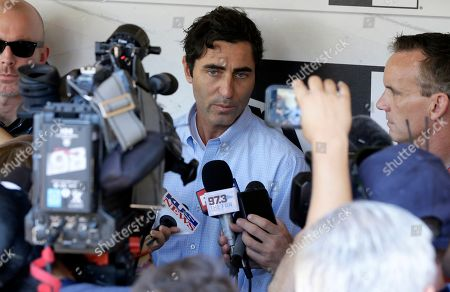 San Diego Padres general manager A.J. Preller, center, talks at a news conference about firing manager Andy Green in San Diego, . General manager A.J. Preller said Green, in his fourth season, was fired because the team had regressed in the second half
