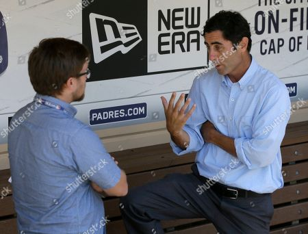 San Diego Padres general manager A.J. Preller, right, talks to a reporter after a news conference about firing manager Andy Green in San Diego