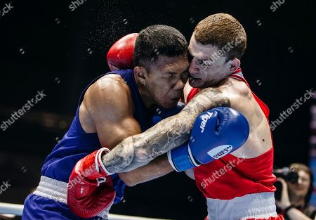 Stock Photo of Russia's Muslim Gadzhimagomedov, right, fights with Ecuador's Julio Cesar Castillo Torres during the men's heavyweight final of the AIBA World Boxing Championships in Yekaterinburg, Russia