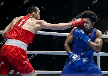Russia's Muslim Gadzhimagomedov, left, fights with Ecuador's Julio Cesar Castillo Torres during the men's heavy weight final of the AIBA World Boxing Championships in Yekaterinburg, Russia