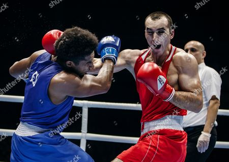 Russia's Muslim Gadzhimagomedov, right, fights with Ecuador's Julio Cesar Castillo Torres during the men's heavy weight final of the AIBA World Boxing Championships in Yekaterinburg, Russia