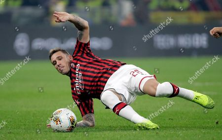 AC Milan's Lucas Biglia controls the ball during a Serie A soccer match between AC Milan and Inter Milan, at the San Siro stadium in Milan, Italy, Saturday, Sept.21, 2019