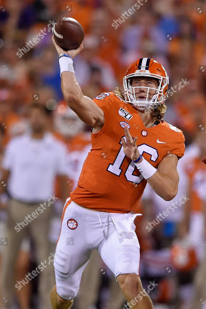 Clemson quarterback Trevor Lawrence throws a pass during the first half of the team's NCAA college football game against Charlotte, in Clemson, S.C