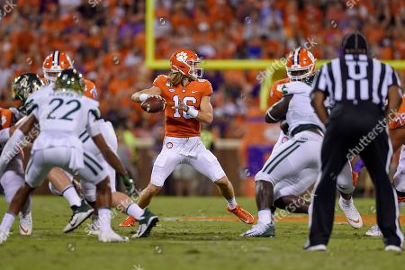 Clemson quarterback Trevor Lawrence prepares to throw a pass during the first half of the team's NCAA college football game against Charlotte, in Clemson, S.C