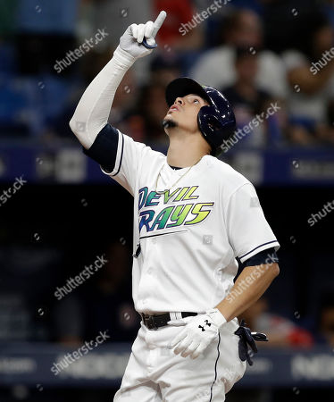 Tampa Bay Rays' Willy Adames celebrates his solo home run off Boston Red Sox relief pitcher Josh Taylor during the seventh inning of a baseball game, in St. Petersburg, Fla