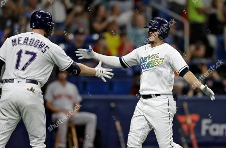 Austin Meadows, Willy Adames. Tampa Bay Rays' Willy Adames, right, celebrates with Austin Meadows after Adames his a solo home run off Boston Red Sox relief pitcher Josh Taylor during the seventh inning of a baseball game, in St. Petersburg, Fla