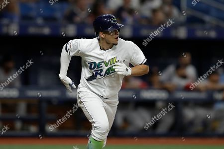 Stock Picture of Tampa Bay Rays' Willy Adames watches his solo home run off Boston Red Sox relief pitcher Josh Taylor during the seventh inning of a baseball game, in St. Petersburg, Fla