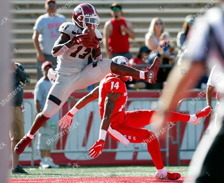 Stock Picture of New Mexico State wide receiver Tony Nicholson (13) catches a pass in the end zone to score a touchdown against New Mexico cornerback Michael LoVett (14) during the first half of an NCAA college football game on in Albuquerque, N.M