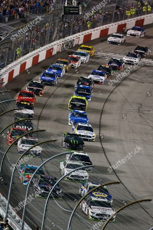 Brad Keselowski (2) leads the field at the start of the NASCAR Cup Series auto race at Richmond Raceway in Richmond, Va
