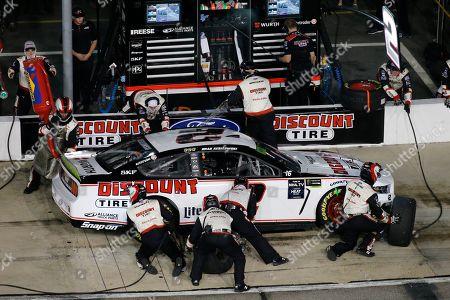 Brad Keselowski makes a pit stop during the NASCAR Cup Series auto race at Richmond Raceway in Richmond, Va