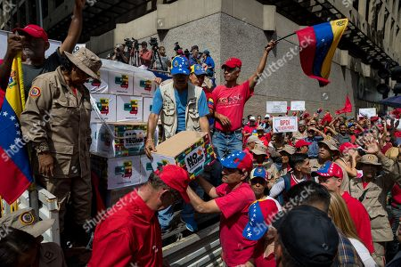Supporters of the Venezuelan government take part in a march to deliver a petition with 13 million signatures denouncing the US blockade on Venezuelan state goods to the Vice presidency of the country, in Caracas, Venezuela, 21 September 2019. Vice President Delcy Rodriguez said that she will denounce the alleged connection of the head of the National Assembly Juan Guaido with the Colombian criminal group 'Los Rastrojos' to the United Nations, where she will also carry more than petition with 13 million signatures.