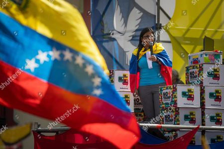 Vice President of Venezuela Delcy Rodriguez  speaks to supporters of the Venezuelan government during a march to deliver a petition with 13 million signatures denouncing the US blockade on Venezuelan state goods to her office prior to Rodriguez' attendance of the United Nations General Assembly, in Caracas, Venezuela, 21 September 2019. Vice President Delcy Rodriguez said that she will denounce the alleged connection of the head of the National Assembly Juan Guaido with the Colombian criminal group 'Los Rastrojos' to the United Nations, where she will also carry more than petition with 13 million signatures.