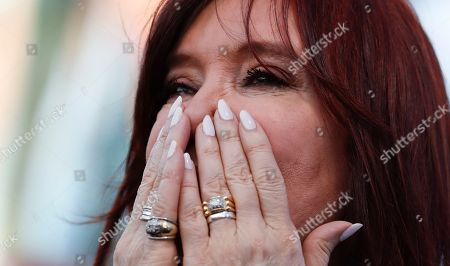"""Former President Cristina Fernandez gestures during the presentation of her book in Buenos Aires, Argentina, . Fernandez returns to the public eye in Argentina on Saturday in an event to present her book """"Sincerely"""" just weeks out from presidential election in which the former two-term leader is running as vice presidential candidate in an opposition ticket"""