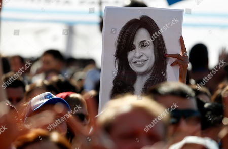 """A man holds a drawing of former President Cristina Fernandez during the presentation of her book in Buenos Aires, Argentina, . Fernandez returns to the public eye in Argentina on Saturday in an event to present her book """"Sincerely"""" just weeks out from presidential election in which the former two-term leader is running as vice presidential candidate in an opposition ticket"""