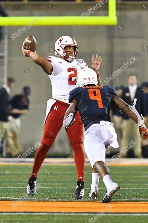 Quarterback Adrian Martinez (2) of the Nebraska Cornhuskers attempts to throw a pass during the NCAA football game between the Illinois vs Nebraska at Memorial Stadium in Champaign, Illinois