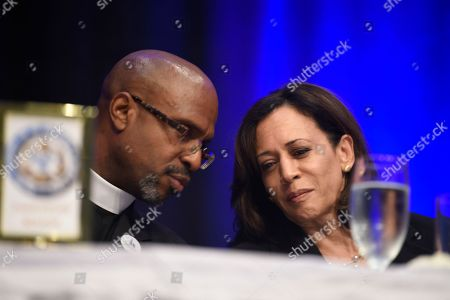 Kamala Harris, Rev. Eric Manning. Democratic presidential candidate Kamala Harris, D-Calif., confers with the Rev. Eric Manning, pastor of Mother Emanuel A.M.E. Church, ahead of her remarks to the Charleston NAACP banquet, in Charleston, S.C