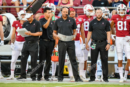 Stock Image of Stanford Cardinal head coach David Shaw looks on from the sideline during the NCAA football game between the Oregon Ducks and the Stanford Cardinal at Stanford Stadium in Stanford, California