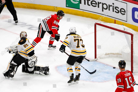 Chicago Blackhawks right wing Patrick Kane (88) scores a winning goal past Boston Bruins goaltender Kyle Keyser (85) during overtime of a preseason NHL hockey game, in Chicago