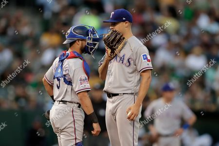 Brock Burke, Isiah Kiner-Falefa. Texas Rangers pitcher Brock Burke, right, speaks with catcher Isiah Kiner-Falefa during the first inning of the team's baseball game against the Oakland Athletics, in Oakland, Calif