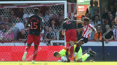 Stoke City goalkeeper, Jack Butland makes a save at the feet of Brentford's Ollie Watkins during Brentford vs Stoke City, Sky Bet EFL Championship Football at Griffin Park on 21st September 2019