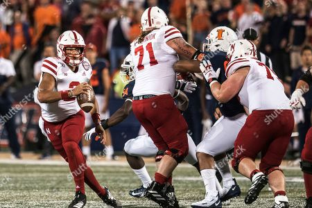Nebraska quarterback Adrian Martinez (2) looks for an open receiver in the first half of an NCAA college football game against Illinois, in Champaign, Ill
