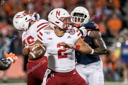 Nebraska quarterback Adrian Martinez (2) passes in the first half of an NCAA college football game against Illinois, in Champaign, Ill