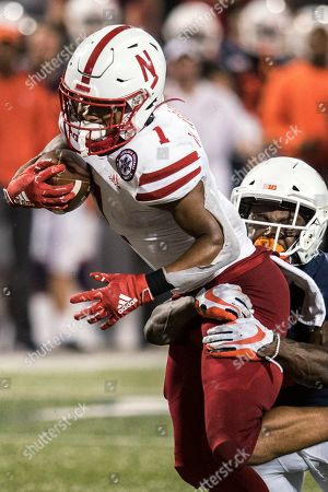 Nebraska's Wan'Dale Robinson (1) shakes off Illinois defender Tony Adams (6) during the second half of a NCAA college football game, in Champaign, Ill